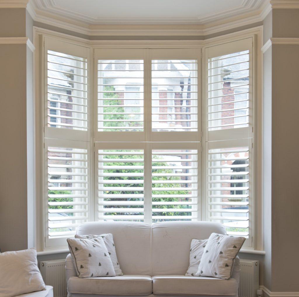 plantation shutters for bay windows